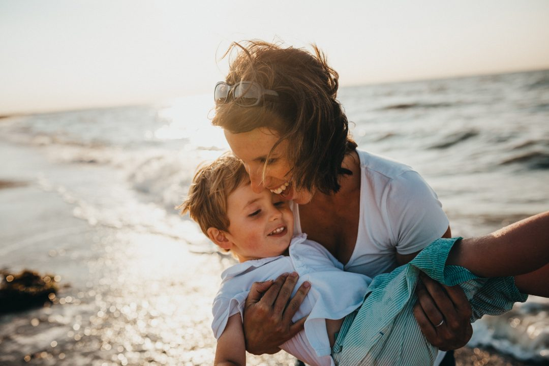 Mother holding child - sustainable vibes