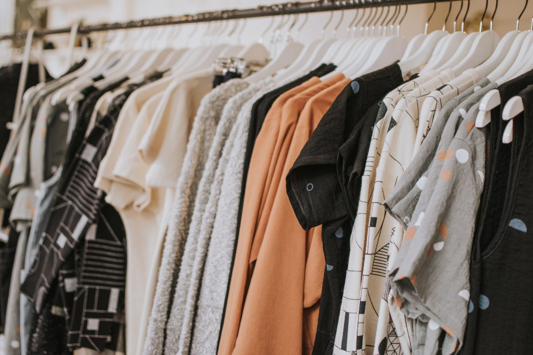 Sustainable clothes on rack - Sustainable Vibes